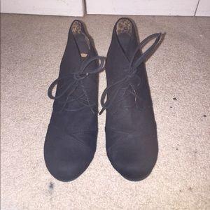 Black suede-like wedge booties